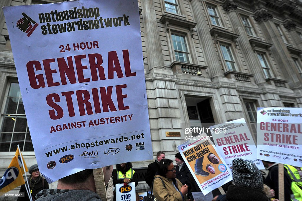 Members of the Public and Commercial Services union (PCS) rally outside the Cabinet Office in central London on April 5, 2013 as they strike for half a day in a row over pay, pensions and terms and condition. AFP PHOTO/CARL COURT