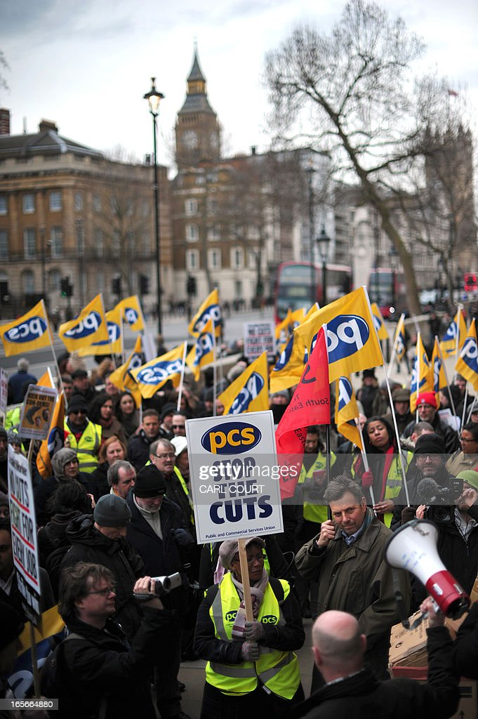Members of the Public and Commercial Services union (PCS) rally outside the Cabinet Office in central London on April 5, 2013 as they strike for half a day in a row over pay, pensions and terms and condition.