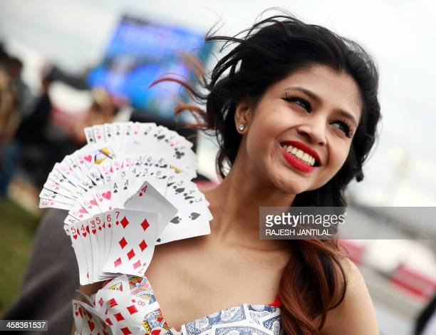 Members of the public and models showcase outfits from local South African designers during the pre race fashion show on the Greyville Race Course in...