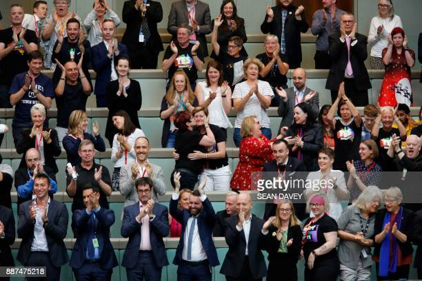 Members of the public applaud after the Australian Parliament passed the samesex marriage bill in the Federal Parliament in Canberra on December 7...