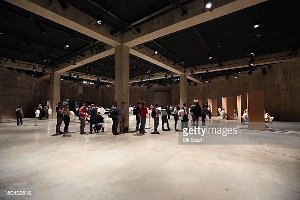 Members of the public are interviewed in booths which form part of artist Jon Fawcett's installation entitled 'EIR' in 'The Tanks' art space in the...