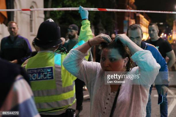 Members of the public are led away from the scene near London Bridge after a suspected terrorist attack on June 4 2017 in London England Police...