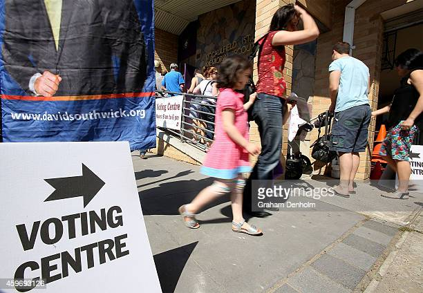Members of the public arrive at the Caulfield District voting centre to vote in the Victorian State Election on November 29 2014 in Melbourne...