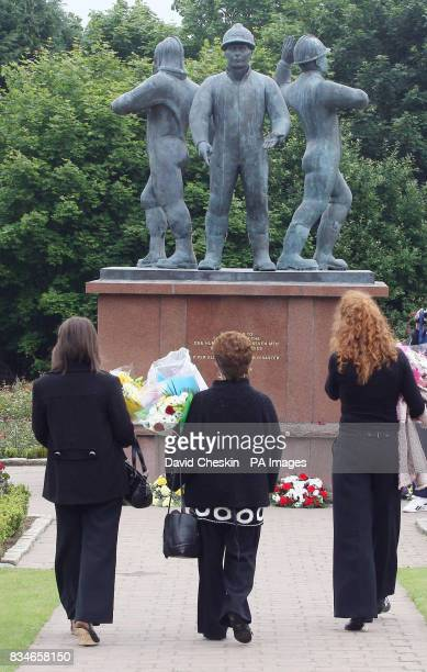 Members of the public arrive at the Hazlehead Park memorial statue for the Piper Alpha memorial service in Aberdeen