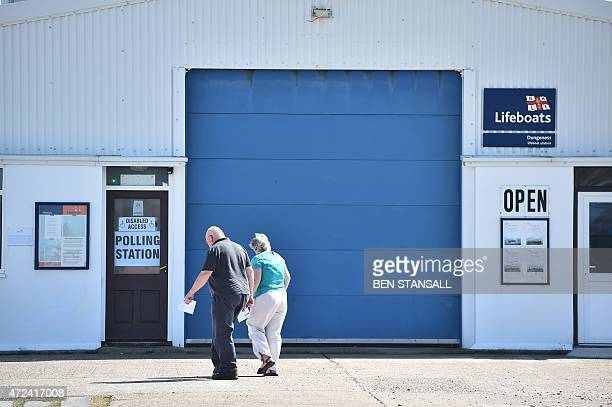 Members of the public arrive to cast their votes at a polling station at a lifeboat station in Dungeness southern England on May 7 as Britain holds a...