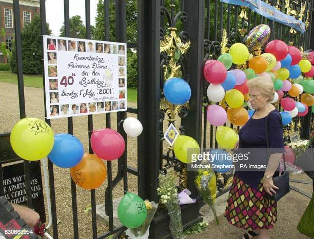 Members of the public at the gates of Kensington Palace to commemorate the 40th birthday of the Princess of Wales Children from London's Royal...