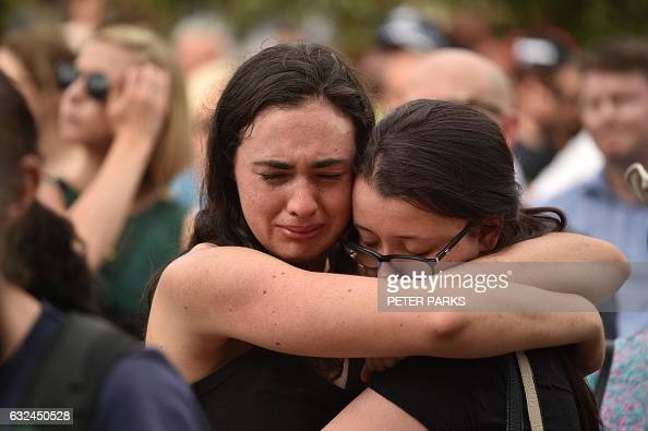 TOPSHOT Members of the public attend a vigil in memory of victims who were mown down by a 26yearold man driving a car at Federation Square in...