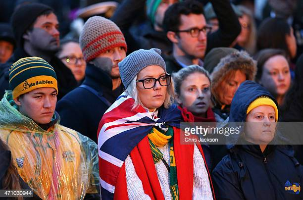 Members of the public attend the early morning ANZAC Day Dawn Service to start at Wellington Arch on April 25 2015 in London England Today marks the...