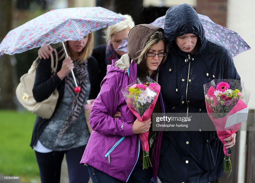 Members of the public bring floral tributes in memory of WPC's Nicola Hughes and Fiona Bone in Hattersley on September 19, 2012 in Manchester, England. Local man Dale Cregan, 29, has been arrested in connection with the shooting of WPC's Nicola Hughes and Fiona Bone, who were killed as they responded to a routine incident at Abbey Gardens in Hattersley shortly before 11am yesterday.