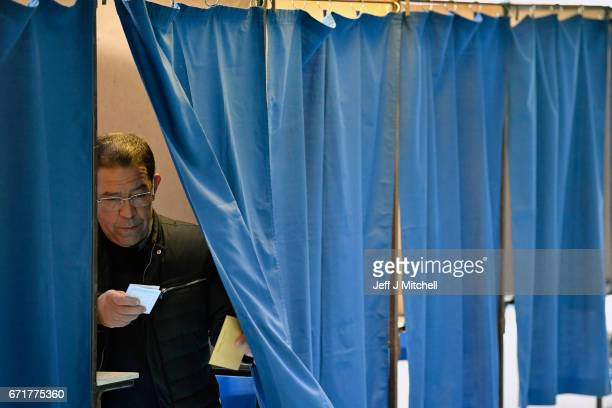 Members of the public cast their vote for the French elections in a polling station on April 23 2017 in Henin Beaumont France French people go to the...