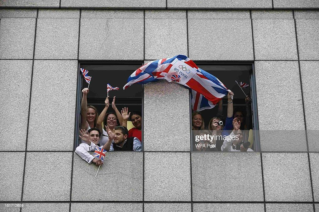 Members of the public cheer on the athletes during the London 2012 Victory Parade for Team GB and Paralympic GB athletes on September 10, 2012 in London, England.