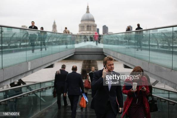 Members of the public cross Millennium Bridge as they commute to work on November 20 2012 in London England The latest unemployment figures published...