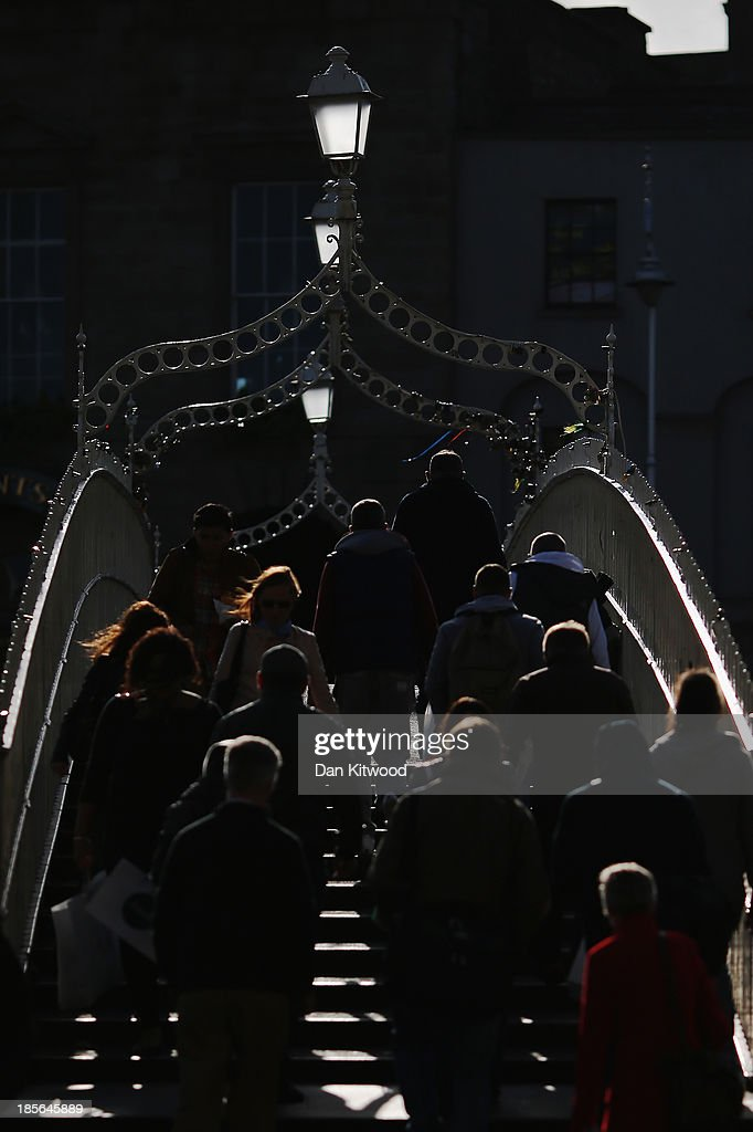 Members of the public cross the Liffey on a footbridge on October 23, 2013 in Dublin, Ireland. Dublin is the capital city of The Republic of Ireland situated in the province of Leinster at the mouth of the River Liffey. The greater Dublin area has a population of around 1.5 Million people.