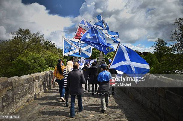 Members of the public cross the old Striling Bridge following a ceremony at the Stirling Bridge Battle Site as the Saltire was raised for the first...