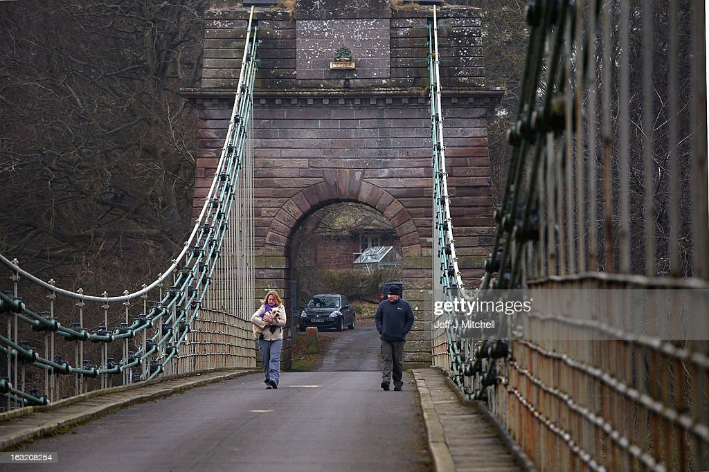 Members of the public cross the Union Bridge on the River Tweed on March 6, 2013 in Berwick Upon Tweed, England. The bridge was built in 1820 and is Europe's oldest surviving iron chain suspension bridge. The bridge which connects the Scottish village of Fishwick to Horncliffe on the English bank is now facing closure with both Scottish Borders Council and Northumberland, citing a £4.7million repair bill for the structure.