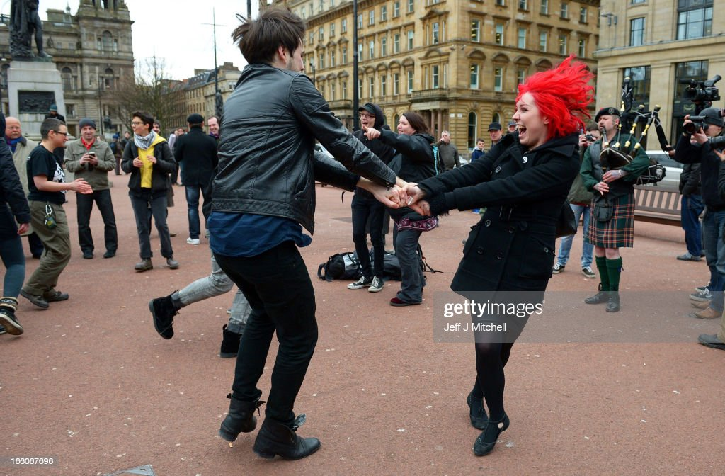 Members of the public dance in George Square to mark the death of Baroness Margaret Thatcher on April 8, 2013 in Glasgow, Scotland. It has been confirmed that Lady Thatcher has died this morning following a stroke aged 87. Margaret Thatcher was the first female British Prime Minster and governed the UK from 1979 to 1990. She led the UK through some turbulent years and contentious issues including the Falklands War, the miners' strike and the Poll Tax riots.