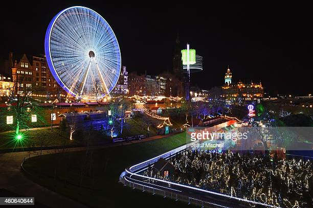 Members of the public enjoy the Christmas Market one of a number of attractions situated in Princes Street Gardens in Edinburgh along with an ice...