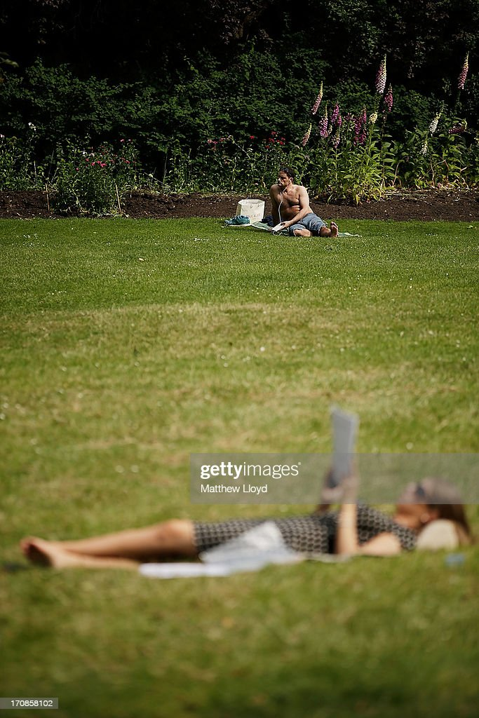 Members of the public enjoy the hot weather in St James Park on June 19, 2013 in London, England. Whilst the country is currently experiencing high temperatures, there has been a prediction by senior meteorologists that Britain may be expecting up to 10 years of rainy summers due to warming of the North Atlantic waters.