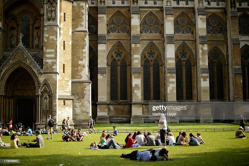 Members of the public enjoy the hot weather outside Westminster Abbey on June 19, 2013 in London, England. Whilst the country is currently experiencing high temperatures, there has been a prediction by senior meteorologists that Britain may be expecting up to 10 years of rainy summers due to warming of the North Atlantic waters.