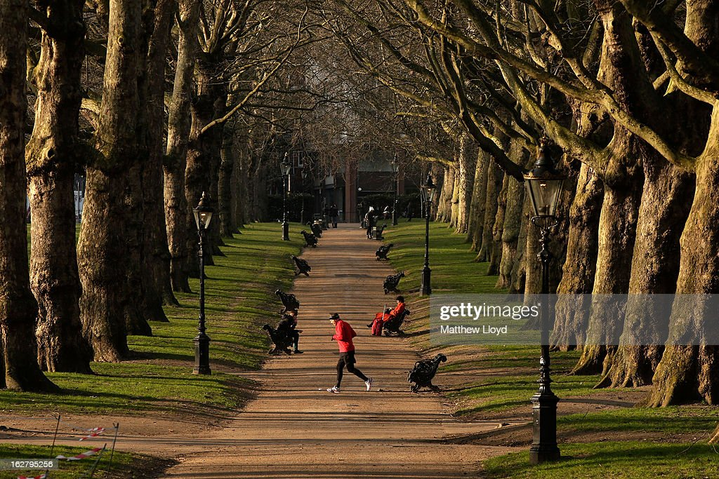 Members of the public enjoy the sunshine in Green Park on February 27, 2013 in London, England. The Met Office has predicted a cold period at Easter.