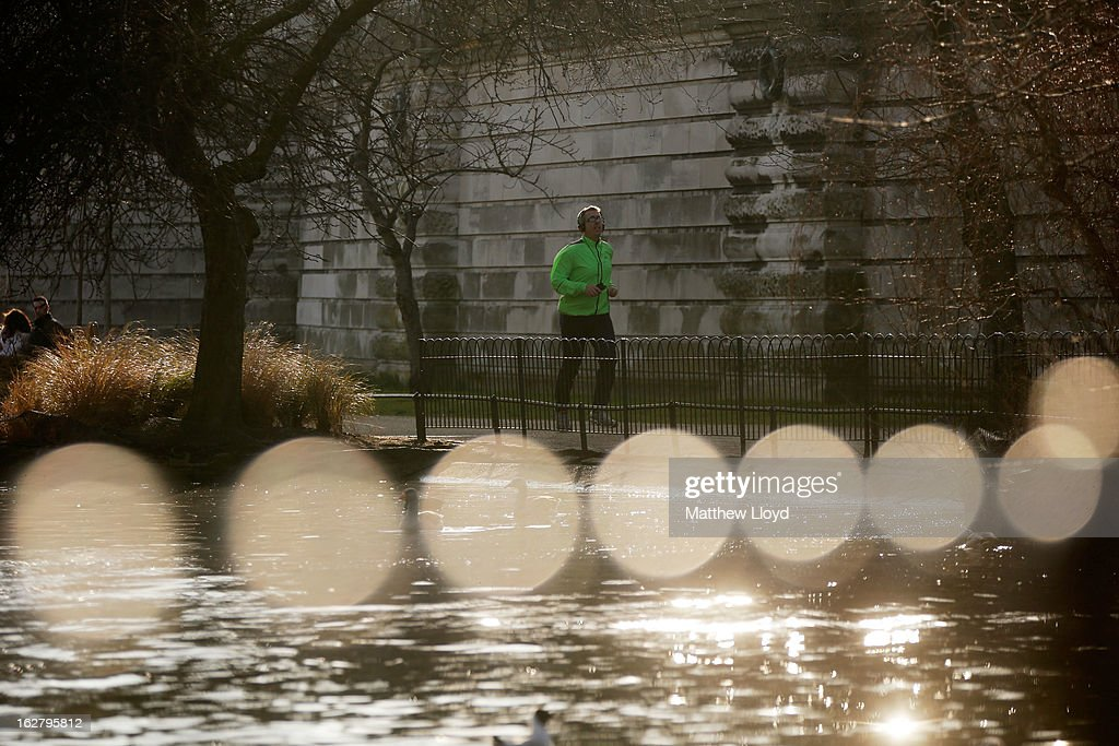 Members of the public enjoy the sunshine in St James' Park on February 27, 2013 in London, England. The Met Office has predicted a cold period at Easter.