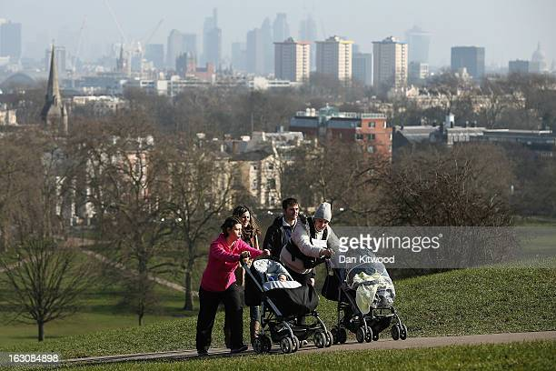 Members of the public enjoy the sunshine on Primrose Hill on March 4 2013 in London England The Met office has predicted the warmest day of the year...