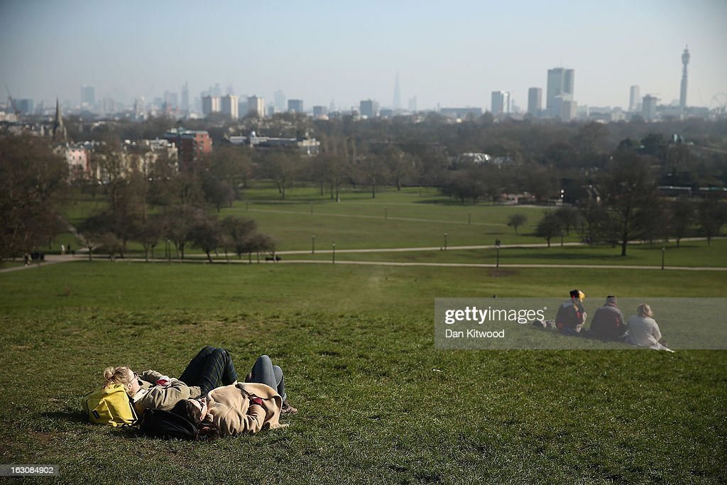 Members of the public enjoy the sunshine on Primrose Hill on March 4, 2013 in London, England. The Met office has predicted the warmest day of the year tomorrow with a top temperature of 15 degrees in some parts of the country.