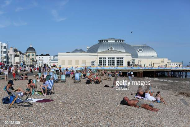 Members of the public enjoy the warm weather at the seaside on August 18 2012 in Worthing England Many areas of the UK are experiencing the hottest...
