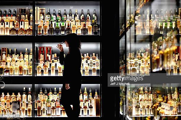 Members of the public examine whisky samples inside the Diageo Claive Vidiz Collection the world's largest collection of Scottish Whisky on display...