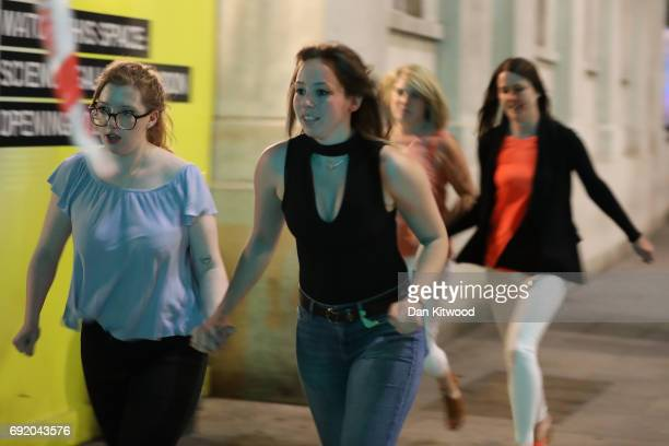 Members of the public flee the scene near London Bridge after a suspected terrorist attack on June 4 2017 in London England Police responded to what...