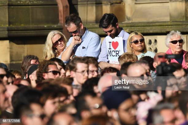 Members of the public gather at a candlelit vigil to honour the victims of Monday evening's terror attack at Albert Square on May 23 2017 in...