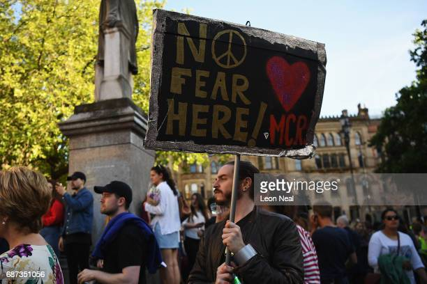 Members of the public gather at a vigil to honour the victims of Monday evening's terror attack at Albert Square on May 23 2017 in Manchester England...