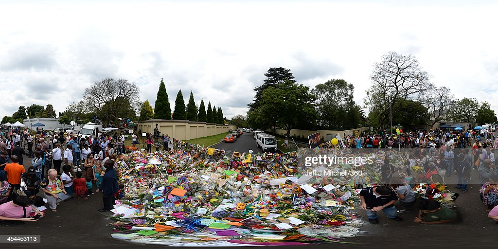 Members of the public gather at former presidents Nelson Mandela's Houghton home to pay their respects on December 8, 2013 in Johannesburg, South Africa. Mandela, also known as Madiba, passed away on the evening of December 5th, 2013 at his home in Houghton at the age of 95. Mandela became South Africa's first black president in 1994 after spending 27 years in jail for his activism against apartheid in a racially-divided South Africa