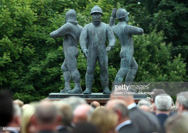 Members of the public gather at the Hasehead Park memorial statue for the Piper Alpha service in Aberdeen