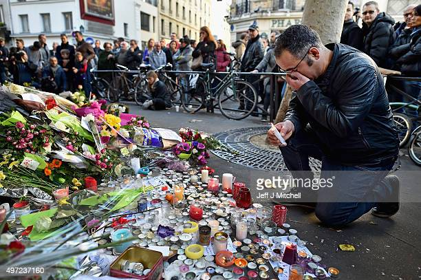 Members of the public gather to lay flowers and light candles at La Belle Equipe restaraunt on Rue de Charonne following Fridays terrorist attack on...