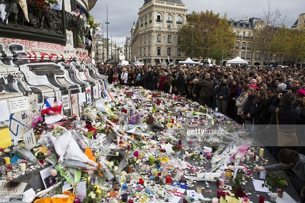Members of the public gather to leave flowers and light candles at Place de la Republique in Paris France on November 16 2015 following the Friday...