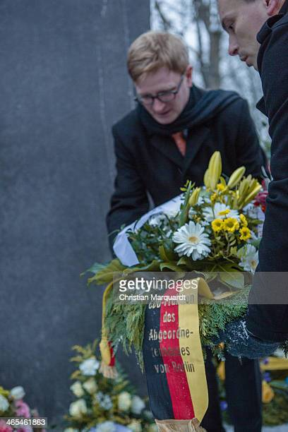 Members of the public lay wreaths at a Holocaust memorial during an event to commemorate the homosexual men and women persecuted by the Nazis during...