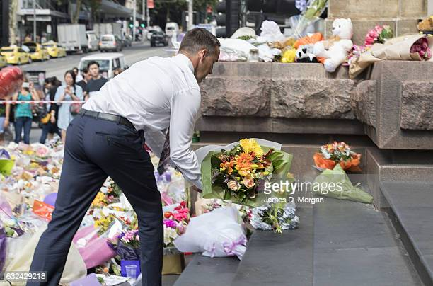 Members of the public leave flowers and messages of condolence on Bourke Street Mall on January 23 2017 in Melbourne Australia Five people including...