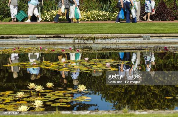 Members of the public leave the flower show at RHS Wisley in Surrey with bags full of plants
