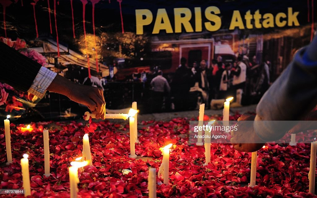 Members of the public light candles for the victims of the Paris terror attacks in front of a press club in Islamabad Pakistan on November 16 2015