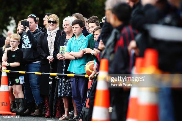 Members of the public line the streets following the Funeral Service for Sir Colin Meads on August 28 2017 in Te Kuiti New Zealand Meads died last...