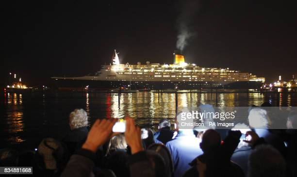 Members of the public line the water's edge in Mayflower Park as the Cunard liner QE2 leaves Southampton docks for the last time