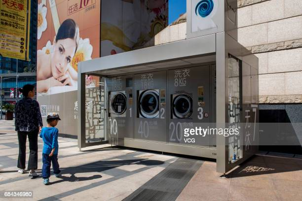 Members of the public look at shared washing machines and drying machines at a commercial plaza of Xuhui District on May 18 2017 in Shanghai China...