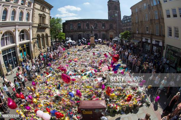 Members of the public look at tributes left for the people who died in Monday's terror attack at the Manchester Arena on May 26 2017 in Manchester...