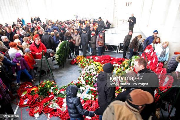 Members of the public look at wreaths laid at Menin Gate memorial Ypres Belguim as the Duke of Edinburgh led tributes to fallen troops at the scene...