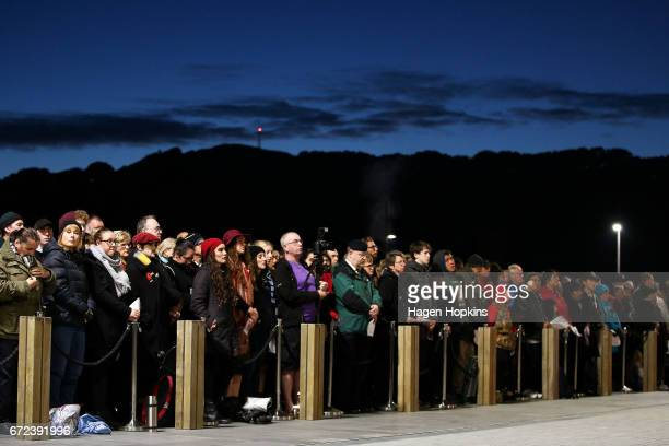 Members of the public look on during Anzac Day dawn service at Pukeahu National War Memorial Park on April 25 2017 in Wellington New Zealand In 1916...