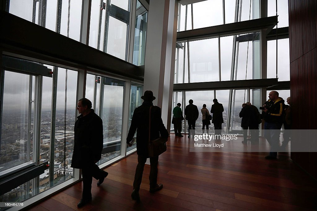 Members of the public look out over London from the View from the Shard on it's opening morning on February 1, 2013 in London, England. Level 72 is the highest viewing gallery in The View from The Shard, and the highest vantage point in Western Europe.