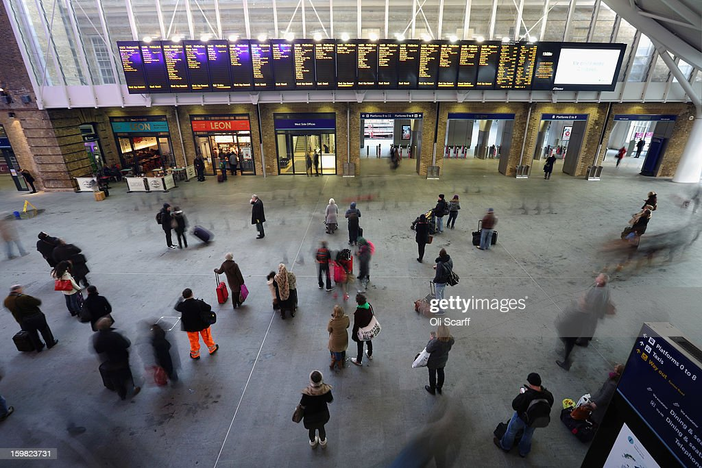 Members of the public make their way through King's Cross train station on January 21, 2013 in London, England. The United Kingdom has suffered a weekend of heavy snowfall with many transport routes affected including the cancellation of several rail services.