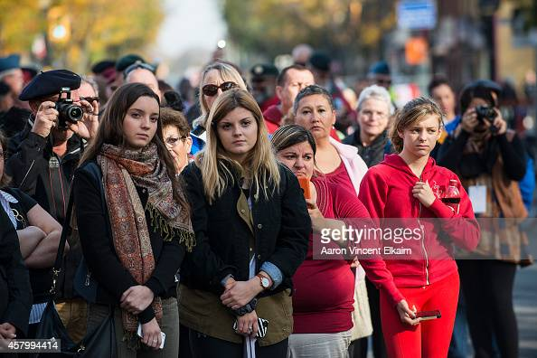 Members of the public mourn during the funeral procession for Cpl Nathan Cirillo at the Christ's Church Cathedral on October 28 2014 in Hamilton...
