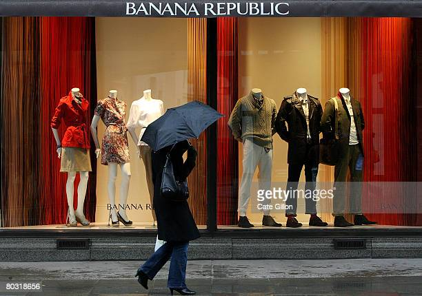 Members of the public pass the Banana Republic store on a rainy day on the corner of Regent Street and Marlborough Road on March 20 2008 in London...